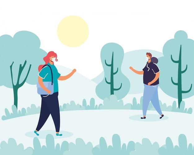 Couple marchant pratiquer la distanciation sociale dans le parc