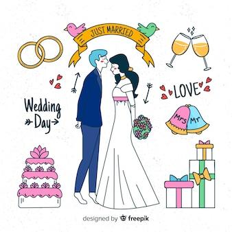 Couple de mariage dessiné à la main avec des éléments