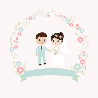 Couple de mariage tenant la couronne de fleurs