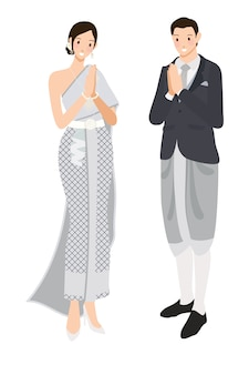 Couple de mariage thaïlandais saluant en costume traditionnel gris argenté