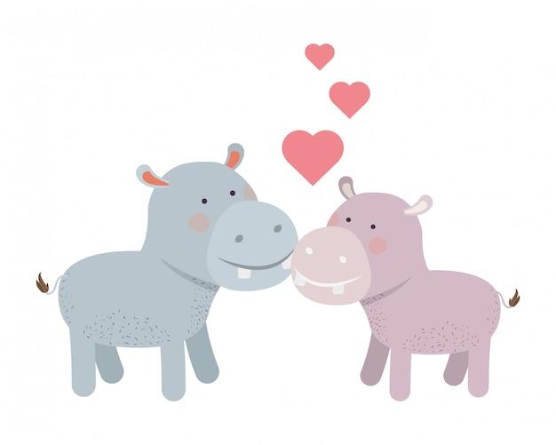 Couple mignon hippopotames avec coeurs