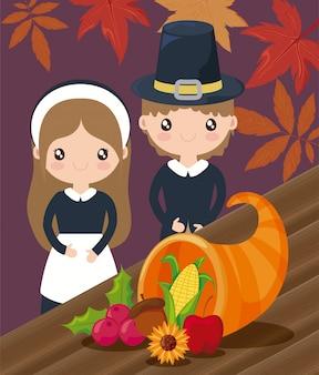 Couple de pèlerins avec des feuilles d'automne