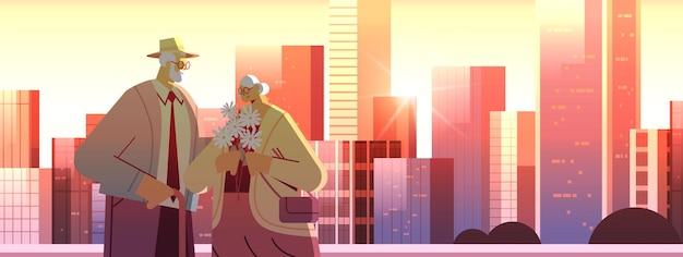 Couple de personnes âgées avec des fleurs ayant une date grands-parents passer du temps ensemble paysage urbain arrière-plan portrait horizontal illustration vectorielle