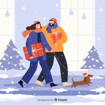 Couple prenant son chien en hiver