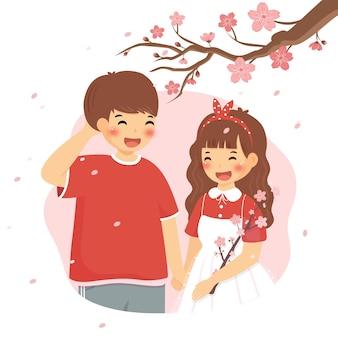 Couple de printemps de fleurs de cerisier