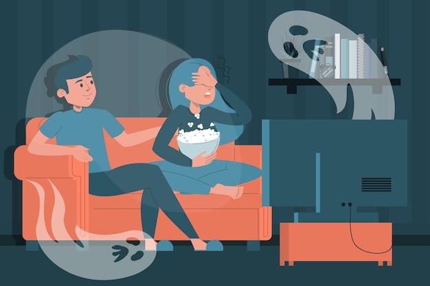 Couple regardant un film d'horreur à la maison