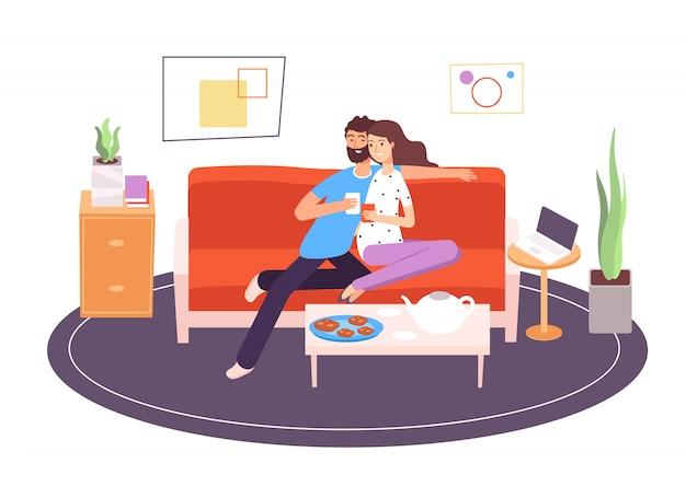 Couple romantique dans la chambre. petite amie et petit ami assis sur un canapé dans l'appartement. gens romantiques, concept intérieur féminin ensemble