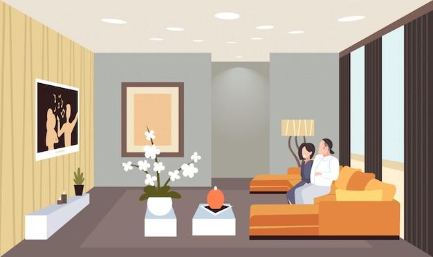 Couple, séance, divan, regarder, tv, homme, femme, amusant, contemporain, salon, intérieur, maison, moderne, appartement, horizontal