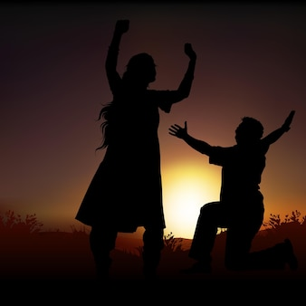 Couple silhouetté au coucher du soleil