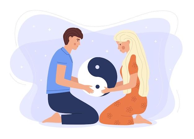 Couple tenant le symbole yin yang.