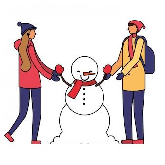 Couple, tenue, bonhomme hiver, mains
