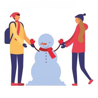 Couple, tenue mains bonhomme hiver