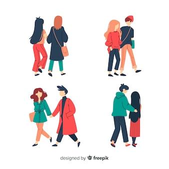 Couples marchant ensemble en habits d'hiver