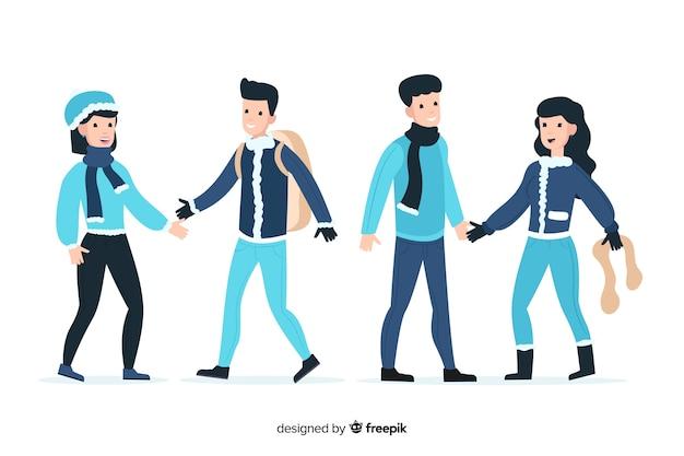 Couples portant des vêtements d'hiver