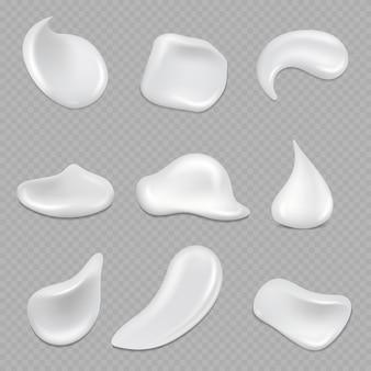 Coups de crème blanche réalistes isolés sur transparent