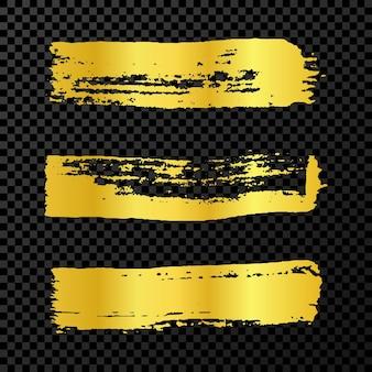 Coups de pinceau grunge or. ensemble de trois bandes d'encre peintes au pinceau. tache d'encre isolée sur fond transparent foncé. illustration vectorielle