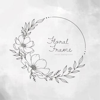 Couronne de cadre floral dessiné à la main sur fond peint blanc