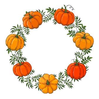 La couronne est faite de citrouilles de couleur. main dessiner un cadre d'automne. modèle pour votre conception. formulaire pour le texte. pour les emballages, les publicités. illustration.