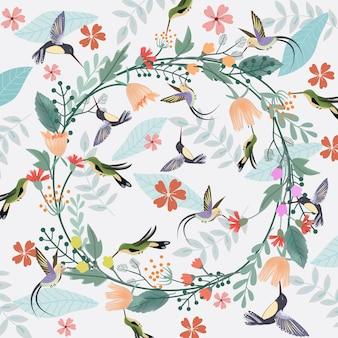 Couronne de fleurs douces et fond de colibri.