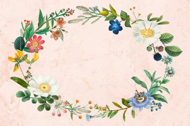 Couronne de fleurs sur fond rose