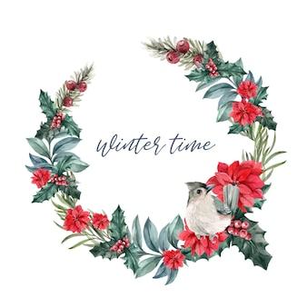 Couronne de fleurs d'hiver avec poinsettias, baies de houx, oiseaux
