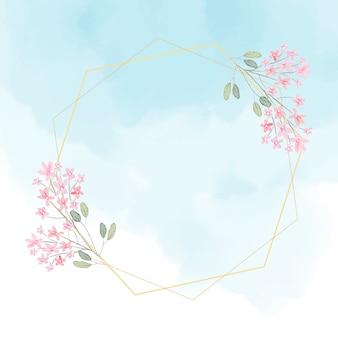 Couronne de fleurs roses avec cadre doré sur fond bleu splash aquarelle