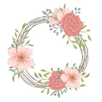Couronne florale avec fleurs roses et rouges