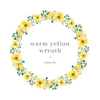 Couronne florale jaune avec des feuilles vertes