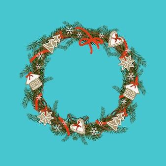 Couronne de noël de branches de sapin avec pain d'épice et flocon de neige décoration festive pour le nouvel an