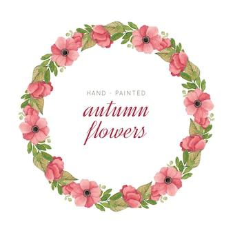 Couronne peinte à la main avec des fleurs et des feuilles à l'aquarelle