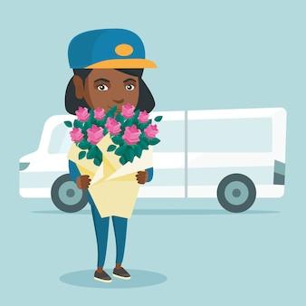 Courrier de livraison tenant un bouquet de fleurs.