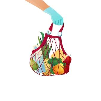 Courriers main gantée tenant un sac écologique en papier avec des produits d'épicerie