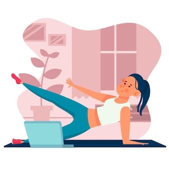 Cours de sport en ligne femme et ordinateur portable