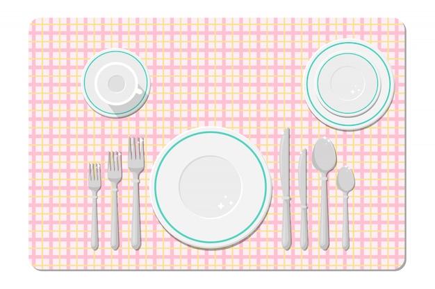 Couverts sur la table, réglage de la table.