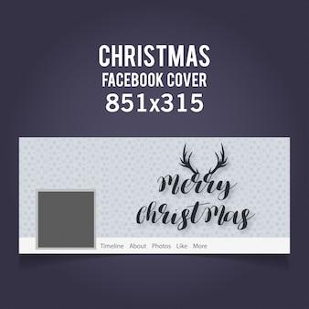 Couverture facebook de noël incluant typograhy et cornes sur fond gris clair