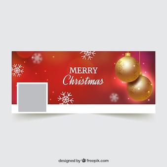 Couverture facebook rouge pour noël avec une boule dorée