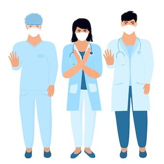 Covid19. épidémie de coronavirus. une équipe de médecins en masques médicaux de protection. arrêtez le concept de virus. un homme montre un geste d'arrêt. assistant de laboratoire.