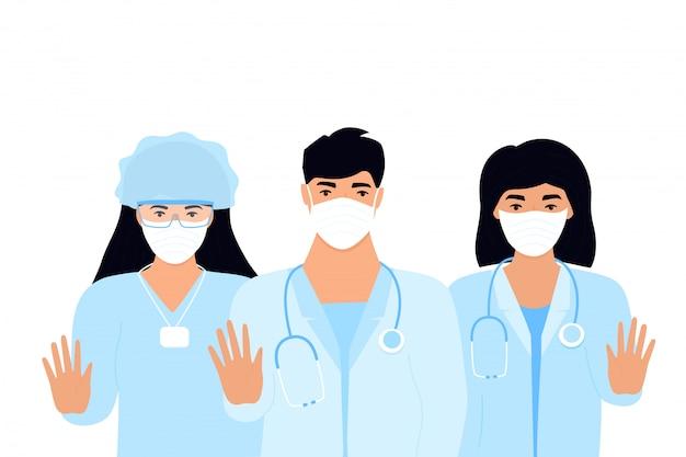 Covid19. épidémie de coronavirus. une équipe de médecins en masques médicaux de protection. arrêtez le concept de virus. un homme montre un geste d'arrêt. travailleuse de laboratoire féminin. infirmière