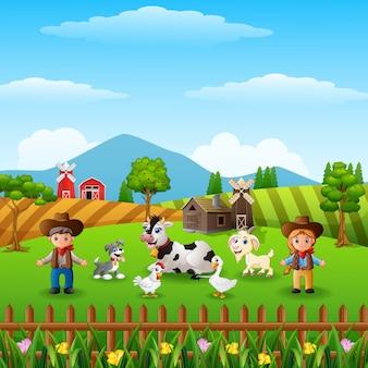 Le cow-boy et cow-girl à la ferme avec des animaux