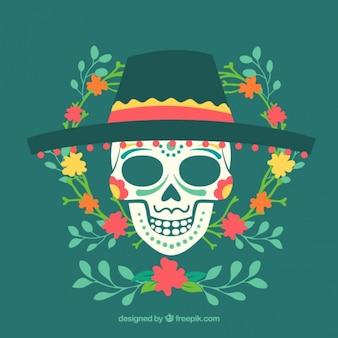 Crâne avec un chapeau et des décorations florales