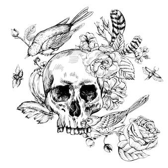 Crâne avec des fleurs, des roses, des oiseaux et des plumes