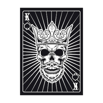 Crâne de roi noir sur carte à jouer. bêche