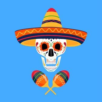 Crâne de sucre peint en sombrero et avec maracas. le jour des morts au mexique. dia de los muertos