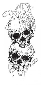 Crâne de tatouage dans la main