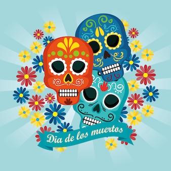 Crânes avec des fleurs et un ruban à l'événement traditionnel