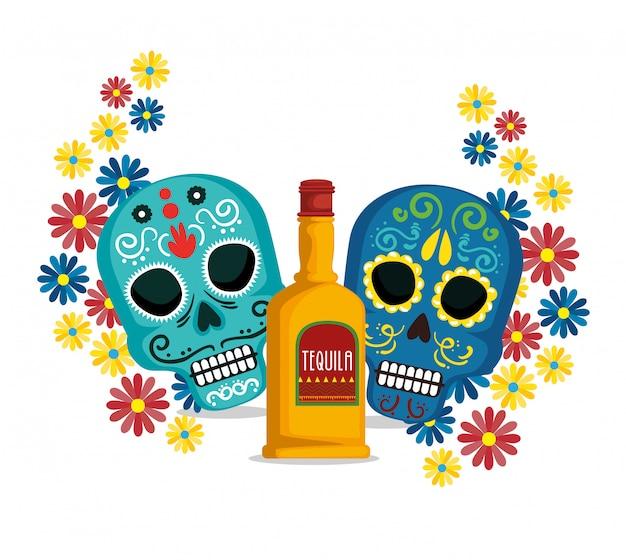 Crânes avec des fleurs et de la tequila à un événement mexicain