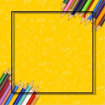 Crayons de couleur sur fond jaune