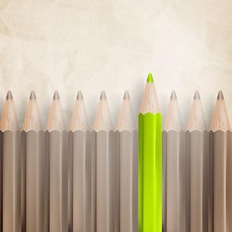 Crayons avec des pointes vers le haut contre du papier texturé parchemin.