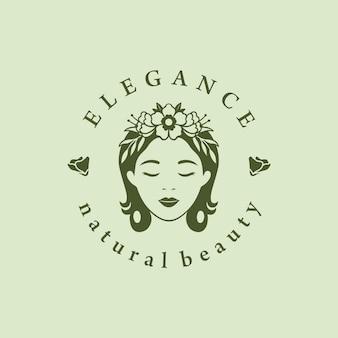 Création de logo de beauté loman avec fleur et feuille