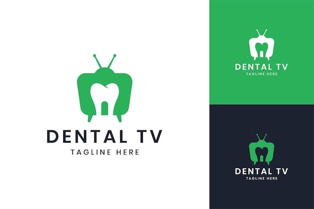 Création de logo d'espace négatif de télévision dentaire
